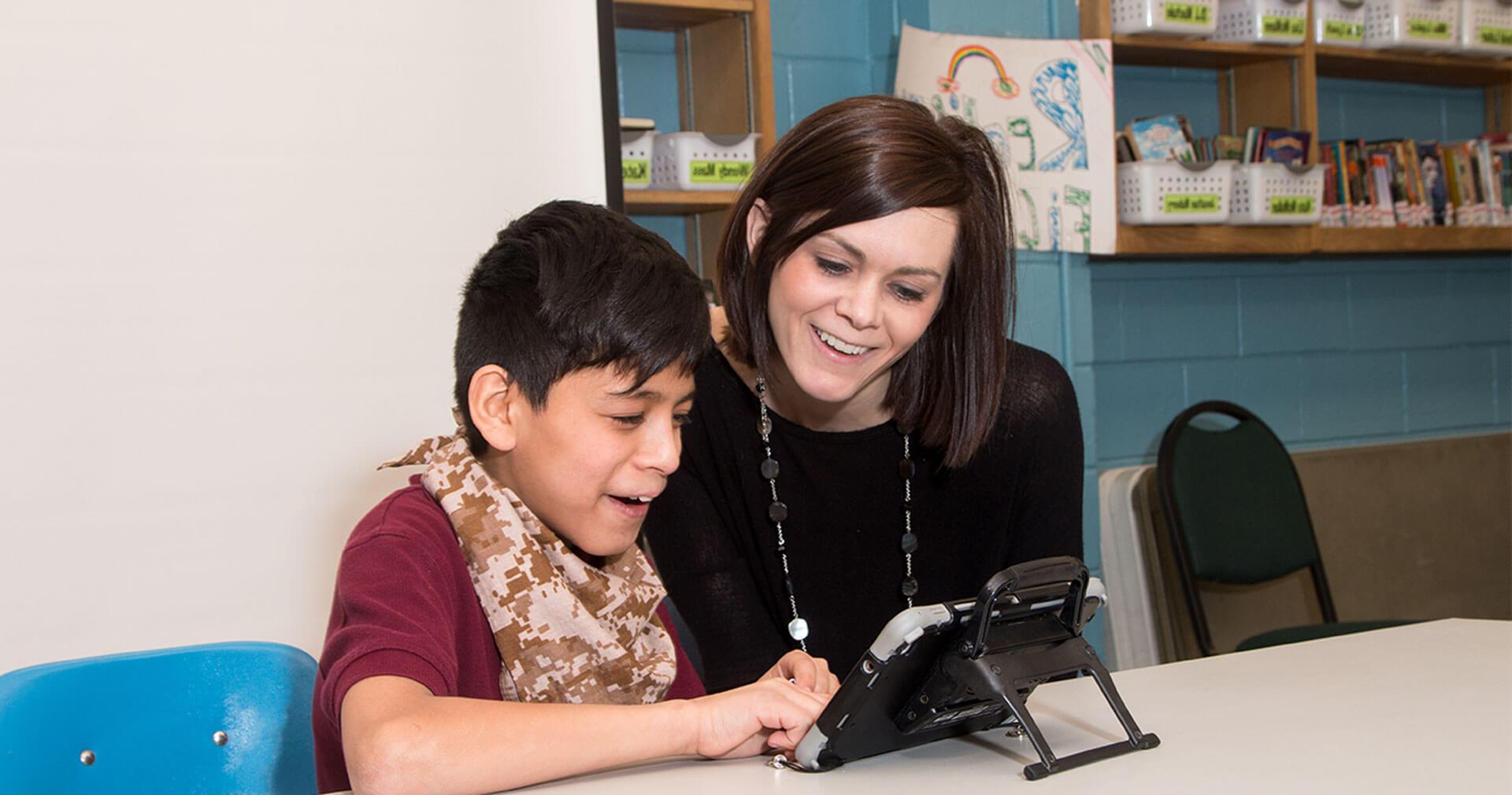 woman tutoring child