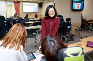 "In the photo, Dr. Chung is pictured giving a speech, entitled ""Augmentative and Alternative Communication Support System in America and My Own AAC Experience"" in December, 2016. The app showed in the picture was developed by Samsung and she was a consultant. Picture by Samsung."