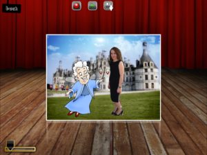 Screenshot from Puppet Pals app with full body cutout of Lauren in a dress on fairy tale background with cartoon fairy grandmother image with wand.